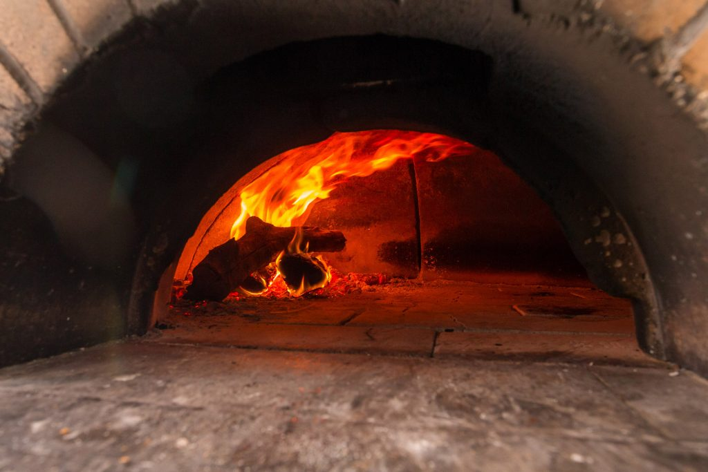 Wood-fired brick ovens have been with us since the dawn of civilization. Medieval brick ovens can be found throughout Europe, often with little variation from the original Roman round, domed oven chamber and front vent design.
