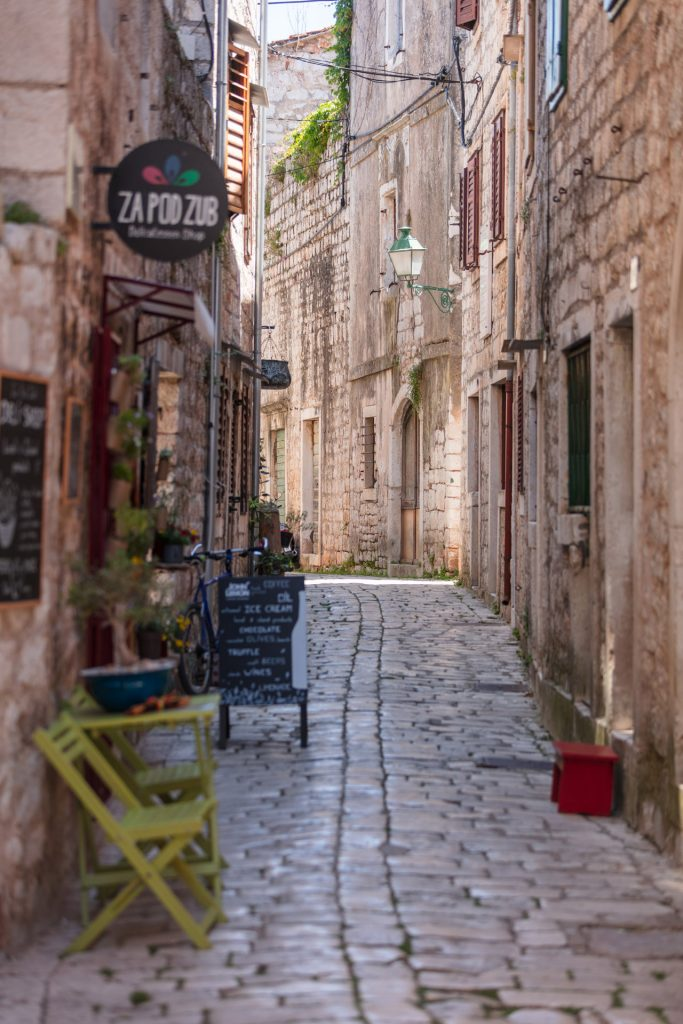 Traditional Mediterranean street with stone houses, picturesque windows and retro lamps / Stari Grad ( Old Town)